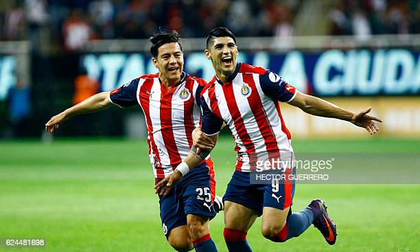 Alan Pulido and Michael Perez of Guadalajara celebrate after scoring against Necaxa during their Mexican Apertura 2016 tournament football match at...