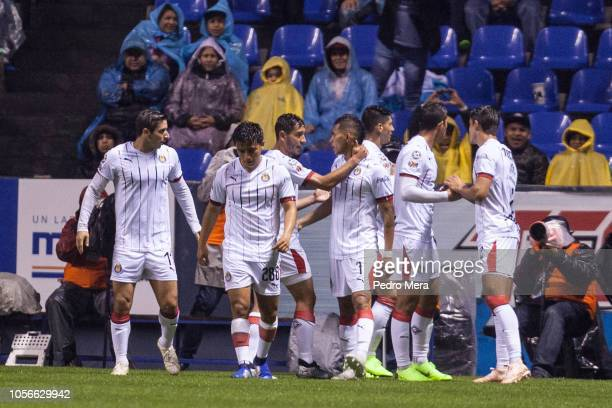 Alan Pulido celebrates with teammates after scoring the first goal of his team during the 15th round match between Puebla and Chivas as part of the...