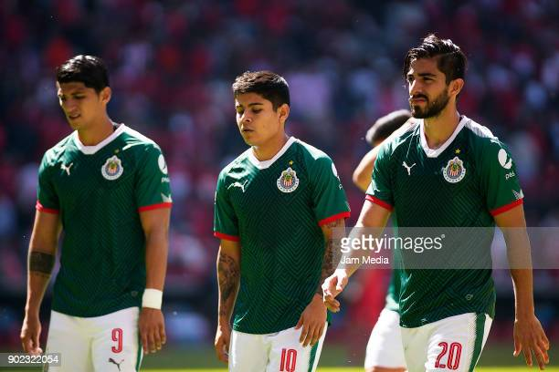 Alan Pulido Juan Basulto and Jesus Sanchez of Chivas look dejected as they leave the field at the end of the first half during the first round match...