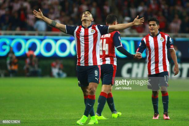 Alan Pulido of Chivas celebrates after scoring his team's first goal during the 11th round match between Chivas and Santos as part of the Torneo...