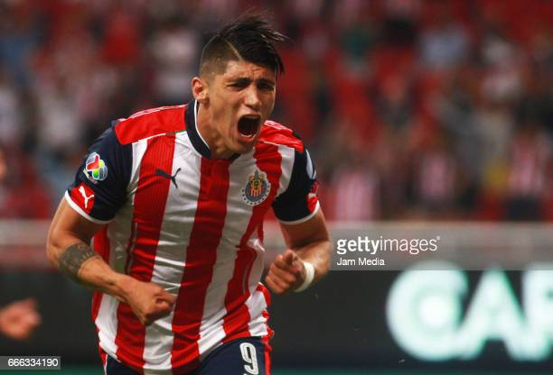 Alan Pulido of Chivas celebrates after scoring his team's first goal during the 13th round match between Chivas and Puebla as part of the Torneo...