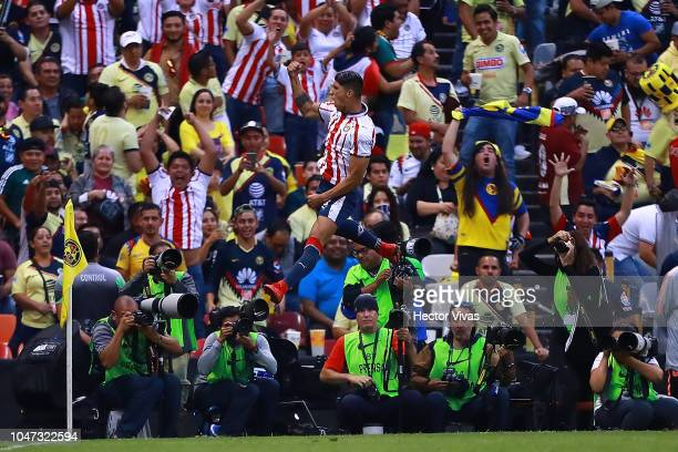 Alan Pulido of Chivas celebrates after scoring the first goal his team during the 11th round match between America and Chivas as part of the Torneo...