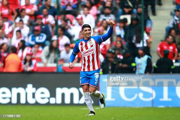 Alan Pulido of Chivas celebrates after scoring the third goal of his team during the 17th round match between Toluca and Chivas as part of the Torneo...