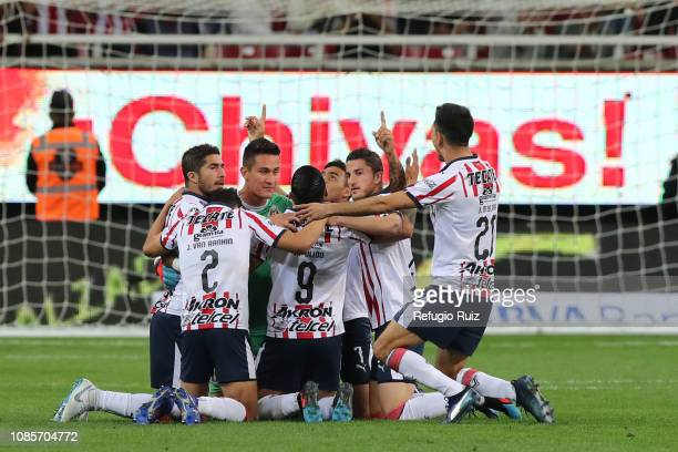 Alan Pulido of Chivas celebrates with his teammates after scoring the first goal of his team during the third round match between Chivas and Toluca...