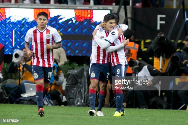 Alan Pulido of Chivas celebrates with his teammates after scoring the first goal of his team during the 4th round match between Chivas and Monterrey...