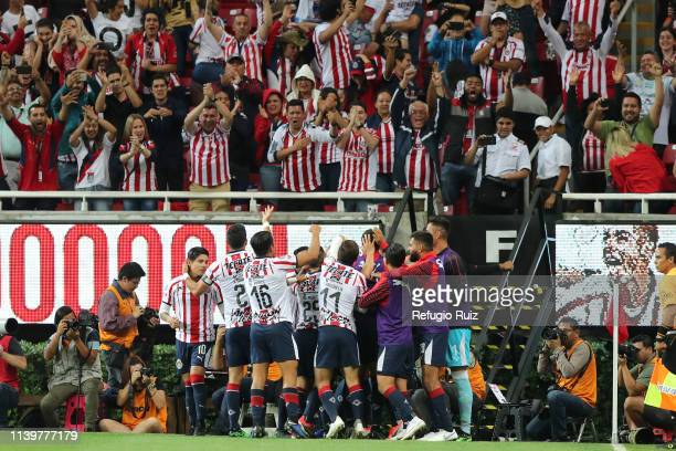 Alan Pulido of Chivas celebrates with his teammates the second goal of his team during the 16th round match between Chivas and Leon as part of the...