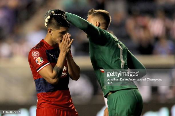 Alan Pulido of Chivas de Guadalajara reacts after his penalty kick attempt was saved by Bartlomiej Bragowski of ACF Fiorentina in the first half...