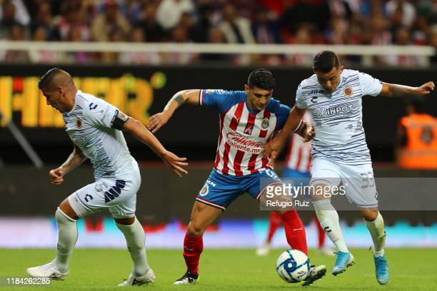 Alan Pulido of Chivas fights for the ball with Carlos Gutiérrez of Veracruz during the 19th round match between Chivas and Veracruz as part of the...