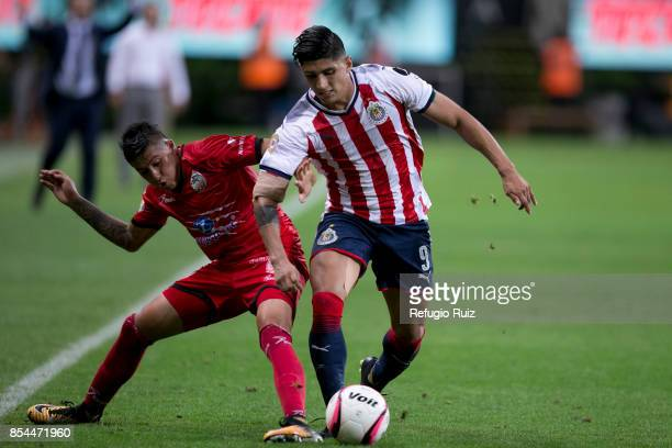 Alan Pulido of Chivas fights for the ball with Diego Jimenez of Lobos during the 11th round match between Chivas and Lobos BUAP as part of the Torneo...
