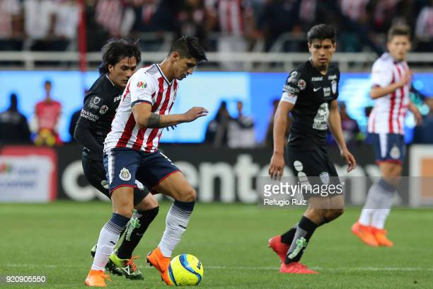 Alan Pulido of Chivas fights for the ball with Jorge Hernandez of Pachuca during the 8th round match between Chivas and Pachuca as part of the Torneo...