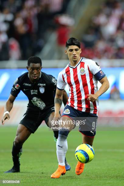 Alan Pulido of Chivas fights for the ball with Oscar Murillo of Pachuca during the 8th round match between Chivas and Pachuca as part of the Torneo...