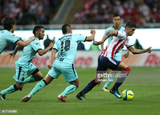 Alan Pulido of Chivas fights for the ball with Osvaldo Martinez of Santos during the 6th round match between Chivas and Santos Laguna as part of the...