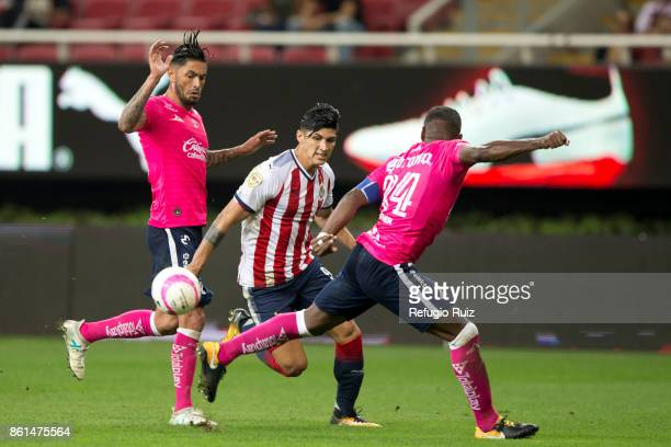 Alan Pulido of Chivas fights for the ball with Rodrigo Millar of Morelia during the 13th round match between Chivas and Morelia as part of the Torneo...