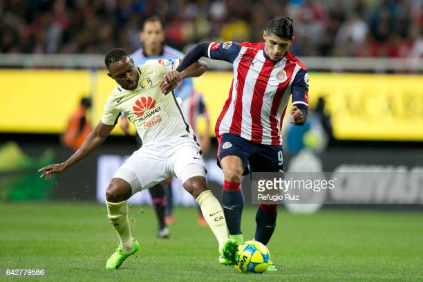 Alan Pulido of Chivas fights for the ball with William Da Silva of America during the 7th round match between Chivas and America as part of the...