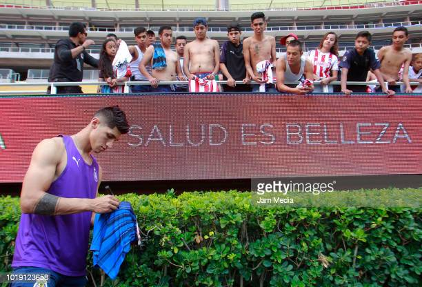 Alan Pulido of Chivas signs autographs to the fans during a match between Chivas and Alebrijes as part of Copa MX Apertura 2018 at Akron Stadium on...