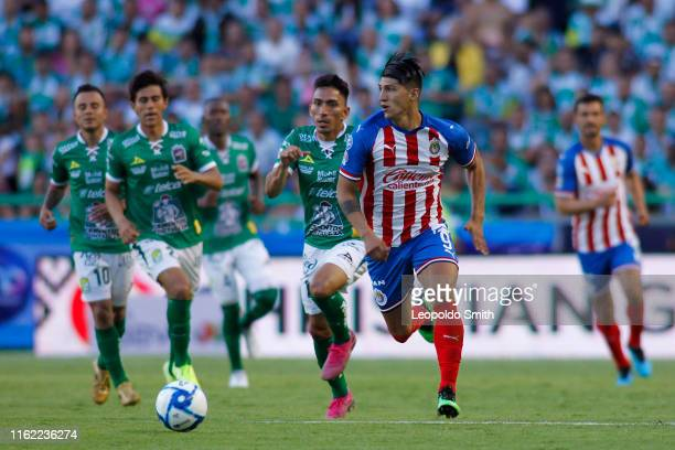 Alan Pulido of Chivas struggles for the ball with Angel Mena of Leon during the 5th round match between Leon and Chivas as part of the Torneo...