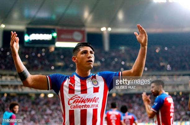 Alan Pulido of Guadalajara celebrates after scoring a goal during the Mexican Apertura 2019 tournament football match between Guadalajara and...