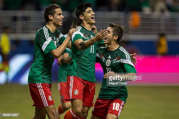 Alan Pulido of Mexico celebrates after scoring with teammates during a FIFA friendly match between Mexico and South Korea at Alamodome Stadium on...