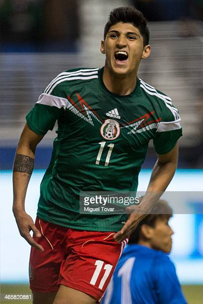 Alan Pulido of Mexico celebrates his second goal during a FIFA friendly match between Mexico and South Korea at Alamodome Stadium on January 29 2014...