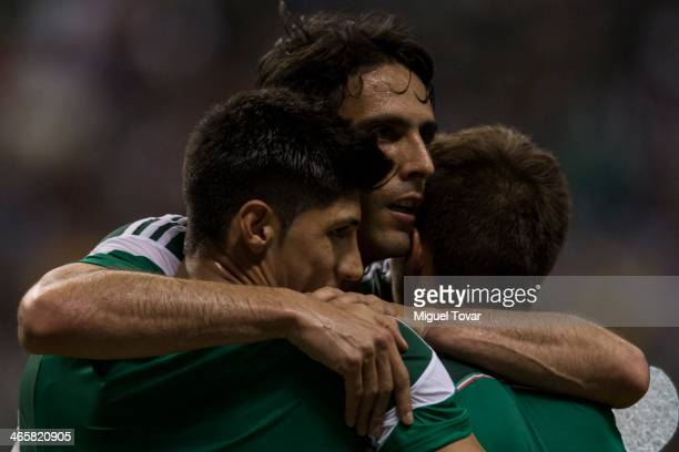 Alan Pulido of Mexico celebrates his second goal with Aldo de Nigris and Isaac Brizuela during a FIFA friendly match between Mexico and South Korea...