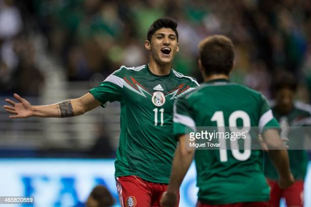 Alan Pulido of Mexico celebrates his second goal with Isaac Brizuela during a FIFA friendly match between Mexico and South Korea at Alamodome Stadium...