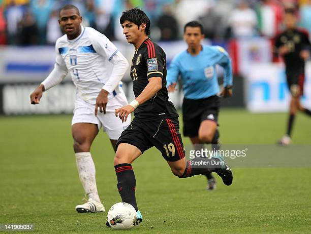 Alan Pulido of Mexico controls the ball in front of Nestor Araujo of Honduras during the fourth day of 2012 CONCACAF Men's Olympic Qualifying at The...
