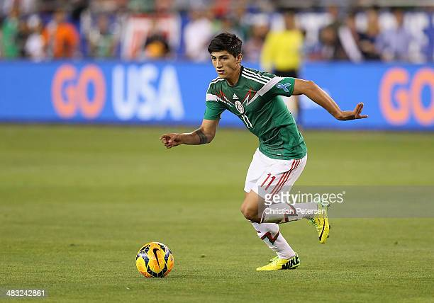 Alan Pulido of Mexico handles the ball during the International Friendly against USA at University of Phoenix Stadium on April 2 2014 in Glendale...