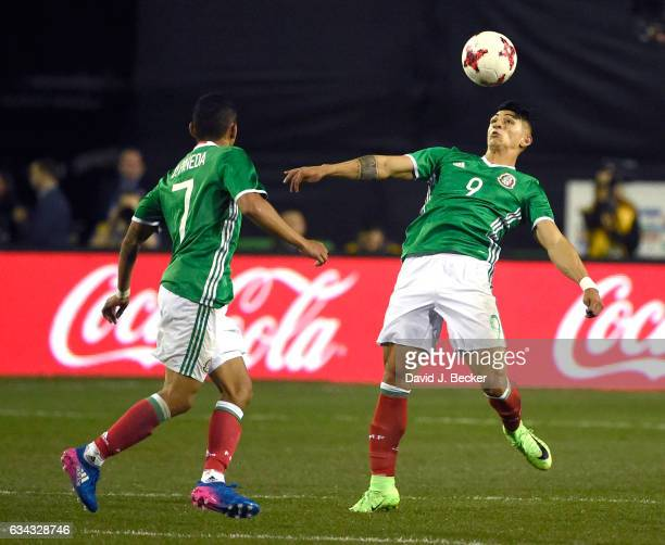 Alan Pulido of Mexico looks to use his body to stop the ball as Orbelin Pinesa looks on during the first half of their exhibition match against...
