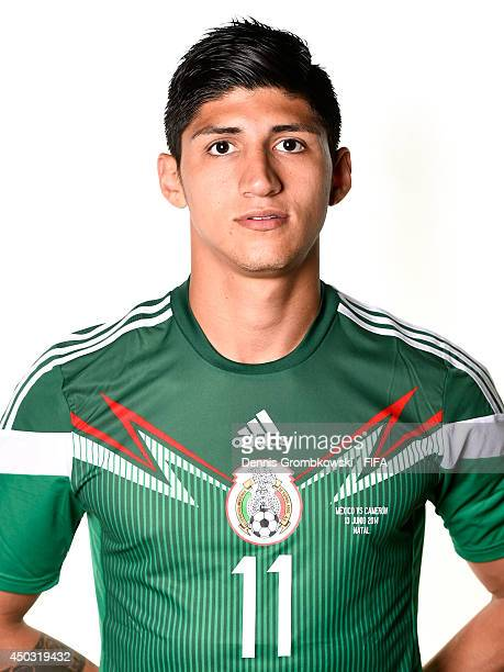 Alan Pulido of Mexico poses during the Official FIFA World Cup 2014 portrait session on June 8 2014 in Santos Brazil