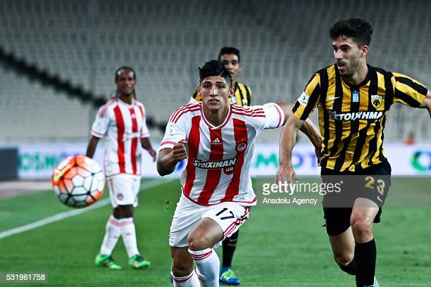 Alan Pulido of Olympiacos and Didac Vella Rosello of AEK Athens vies for the ball during the Greek Cup Final football match between Olympiacos and...