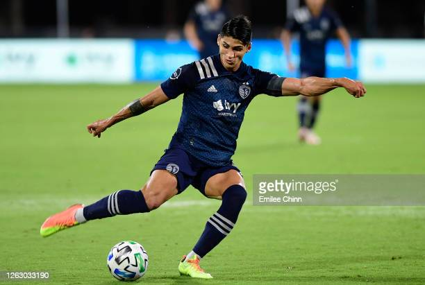 Alan Pulido of Sporting Kansas City takes a shot on goal during a quarterfinals match against Philadelphia Union during the MLS Is Back Tournament at...
