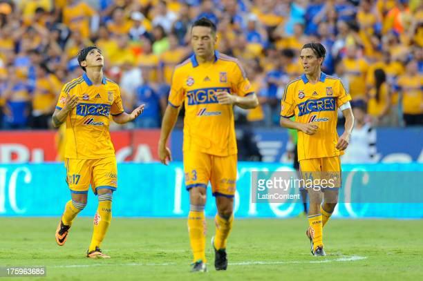 Alan Pulido of Tigres celebrates after scoring during a match between Tigres and Monterrey as part of Apertura 2013 Tournament at Universitario...