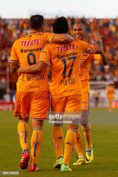 Alan Pulido of Tigres celebrates after scoring during a match between Atlante and Tigres as part of 14th round of Torneo Clausura 2014 Liga MX at...