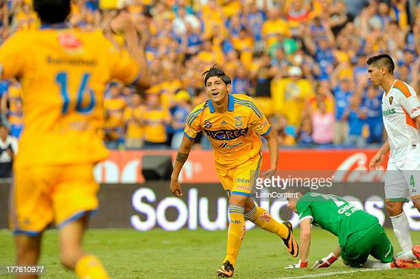 Alan Pulido of Tigres celebrates during a match between Tigres and Jaguares as part of Apertura 2013 Tournament at Universitario Stadium on August 24...