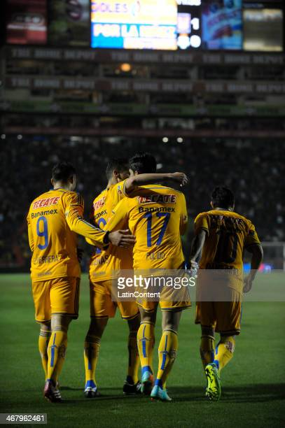 Alan Pulido of Tigres celebrates with teammates after scoring during a match between Tigres UANL and Santos Laguna as part of the Clausura 2014 Liga...