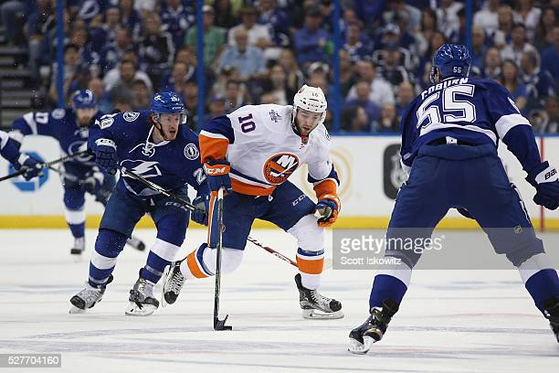 Alan Quine of the New York Islanders skates with the puck against the Tampa Bay Lightning defense in Game Two of the Eastern Conference Second Round...