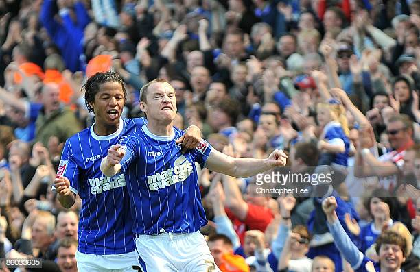 Alan Quinn of Ipswich celebrates scoring their first goal with Giovani Dos Santos during the CocaCola Championship match between Ipswich Town and...