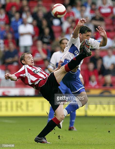Alan Quinn of Sheffield United battles for the ball with Fabio Rochemback of Middlesbrough during the Barclays Premiership match between Sheffield...