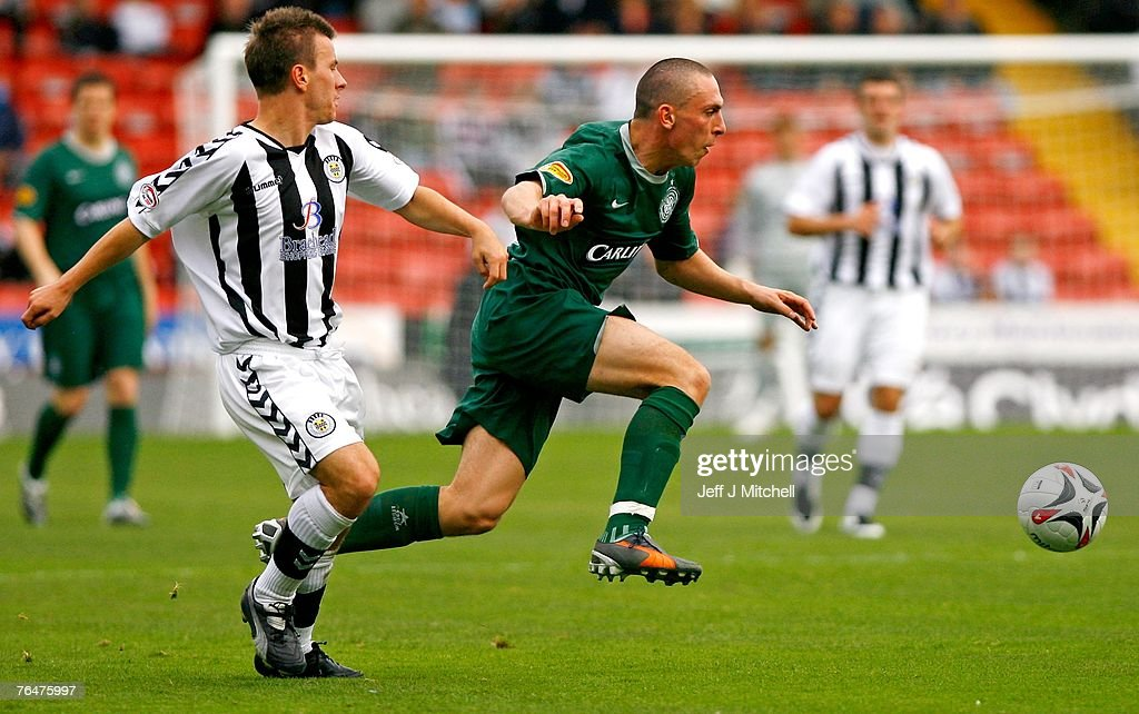 Alan Reid of St Mirren tackles 2 of Celtic during the Scottish Premier League match between Celtic and St Mirren at Love Street on September 2, 2007 in Paisley, Scotland.