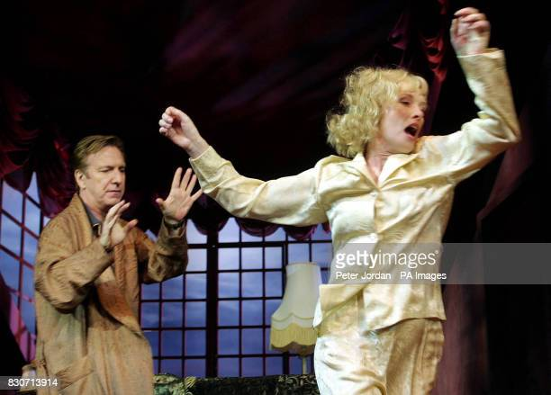 Alan Rickman as 'Elyot throws' Lindsay Duncan as 'Amanda' across the room at a photo call for Howard Davies's production of Noel Coward's 'Private...