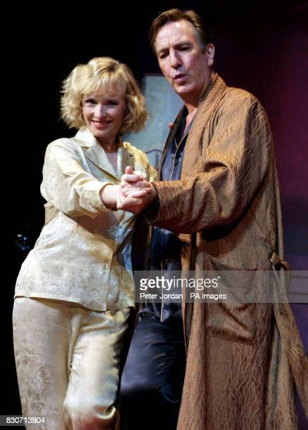 Alan Rickman as'Elyot' and Lindsay Duncan as 'Amanda' dance to music at a photo call for Howard Davies's production of Noel Coward's 'Private Lives'...