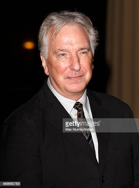 Alan Rickman attends a Dramatic Arts reception hosted by Queen Elizabeth II at Buckingham Palace on February 17 2014 in London England
