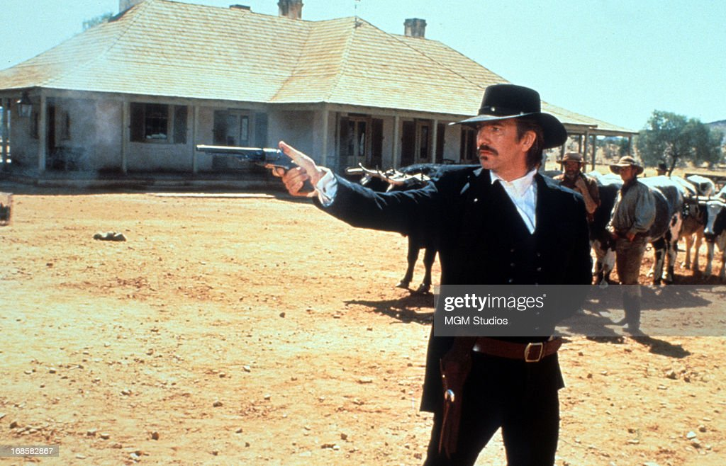 Alan Rickman shoots a pistol in a scene from the film 'Quigley Down Under', 1990.