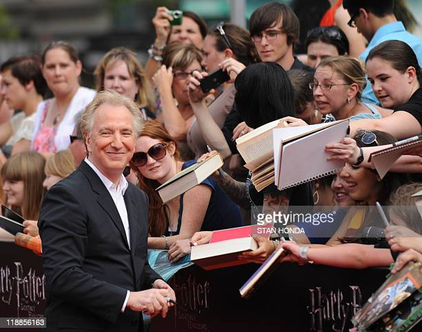 "Alan Rickman signs autographs as he arrives for the North American premiere of ""Harry Potter and the Deathly Hallows – Part 2"" July 11 2011 at..."