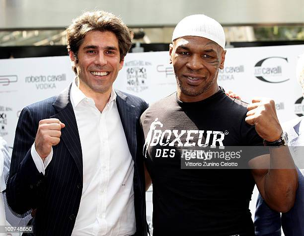 Alan Rizzi and Mike Tyson attend a press conference held at Just Cavalli Cafe on July 9 2010 in Milan Italy