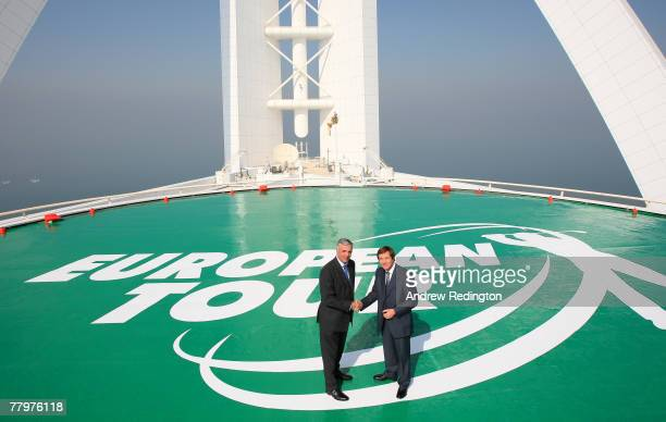 Alan Rogers CEO of Istithmar World Real Estate and George O'Grady Chief Executive of The European Tour pose for a photograph on the helipad of the...
