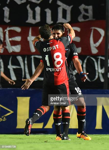 Alan Ruiz of Colon celebrates with Ezequiel Sperduti after scoring the fourth goal of his team during a match between Colon and River Plate as part...