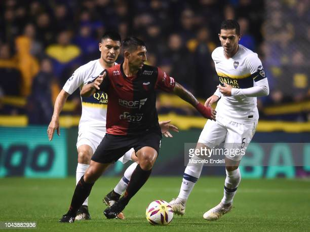 Alan Ruiz of Colon drives the ball during a match between Boca Juniors and Colon as part of Superliga 2018/19 at Estadio Alberto J Armando on...