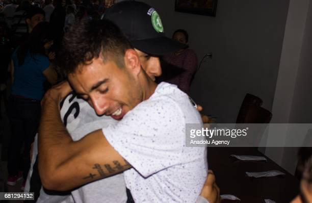 Alan Ruschel one of the survivors of the Chapecoense team hugs a fan as people pay tribute to the players of Brazilian team Chapecoense in front of...