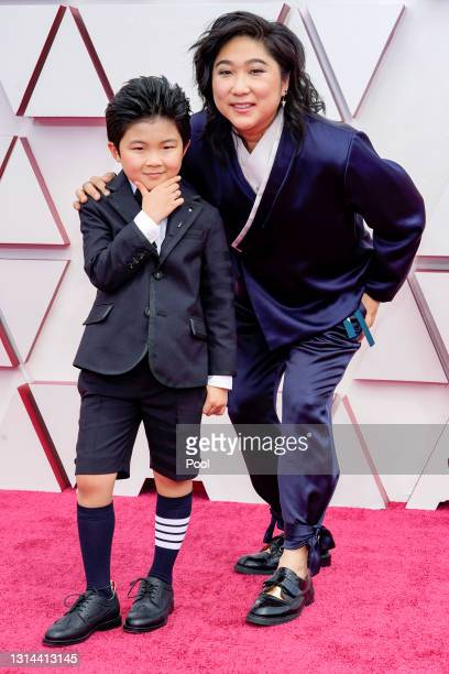 Alan S. Kim and Christina Oh attend the 93rd Annual Academy Awards at Union Station on April 25, 2021 in Los Angeles, California.